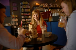 CHASS' Amanda Boykin plays Jenga with friends in an off campus coffee house.