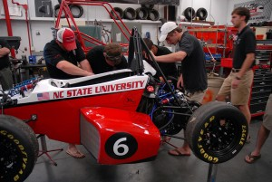 Members of Wolfpack Motorsports work on their latest car.